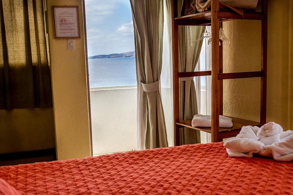 Giường trong phòng chung tại Hotel Sabana