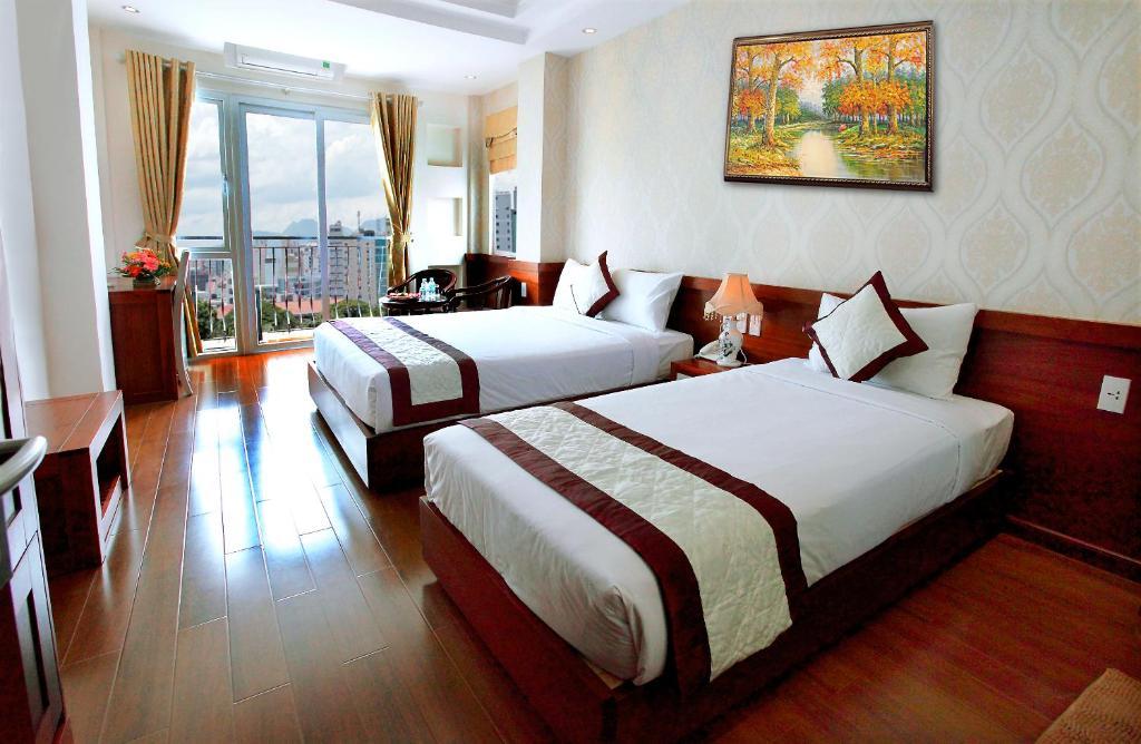 Phòng Grand Deluxe 2 Giường đơn với ban công.