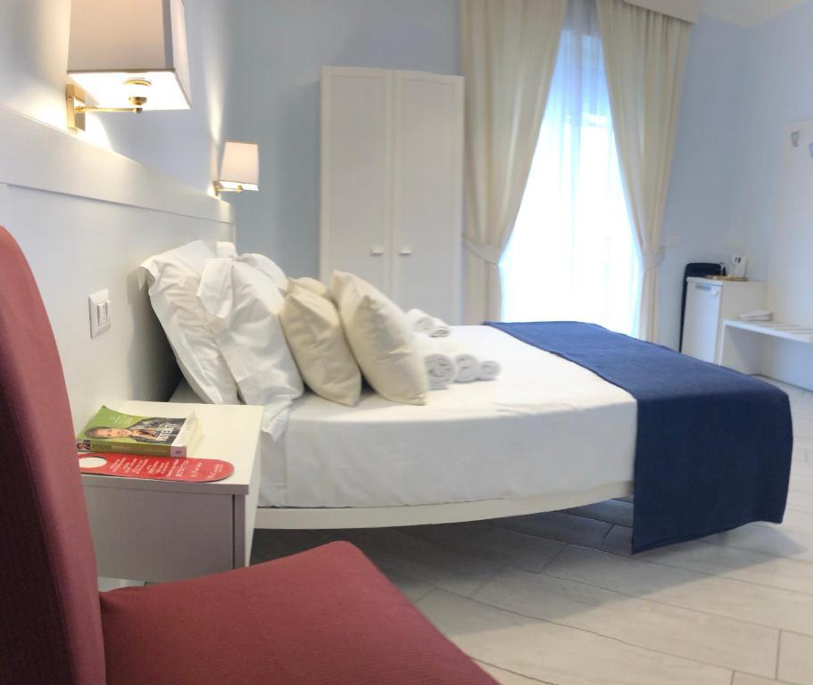 מיטה או מיטות בחדר ב-Real Toledo