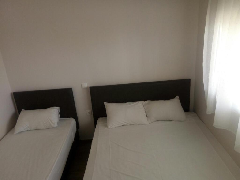 Cama ou camas em um quarto em Villa Olympic Beach