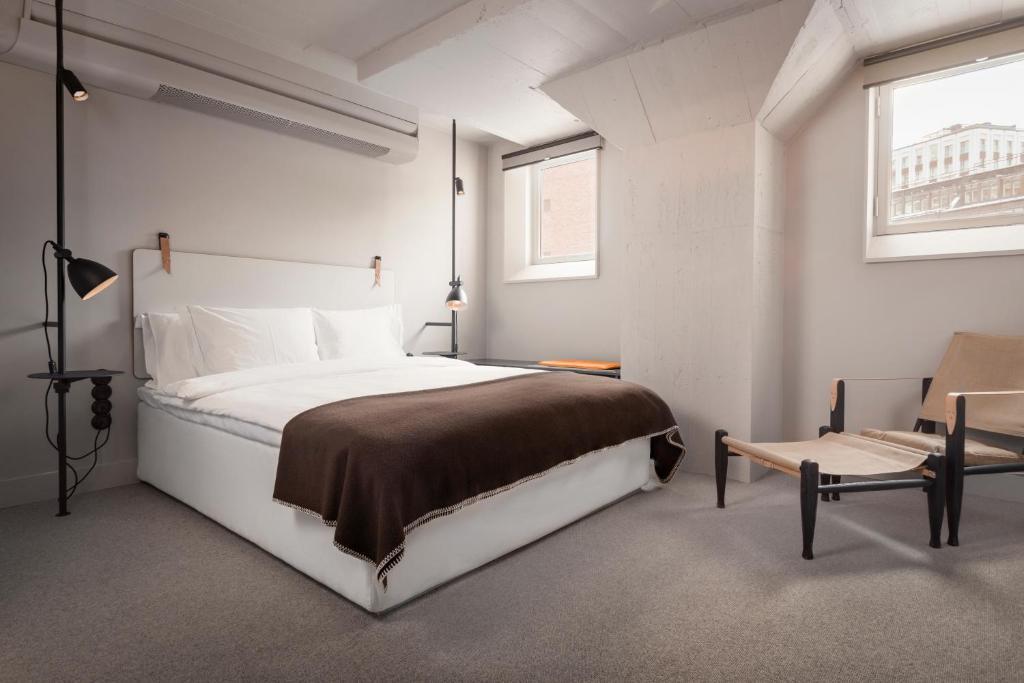 מיטה או מיטות בחדר ב-Blique by Nobis