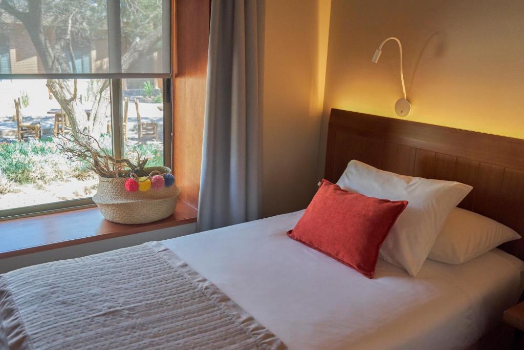 Una cama o camas en una habitación de Hotel La Casa de Don Tomás
