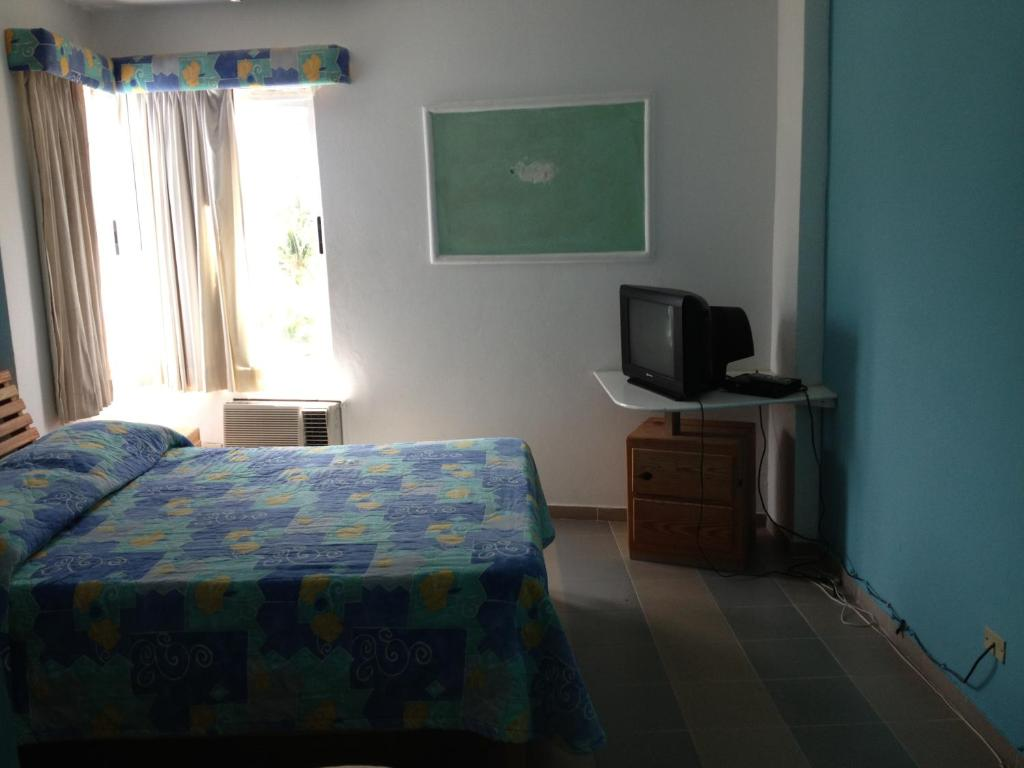 Hotel arena coco playa boca chica reserva tu hotel con for Hotel familiar nunez