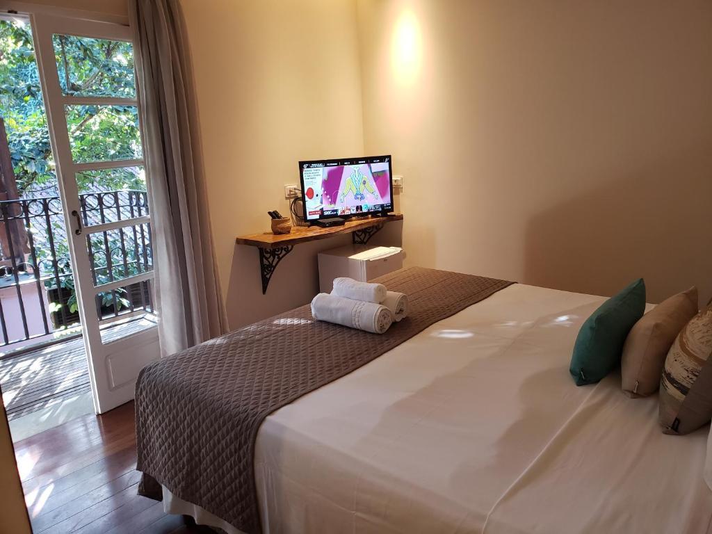 Cama ou camas em um quarto em Pousada Camburi