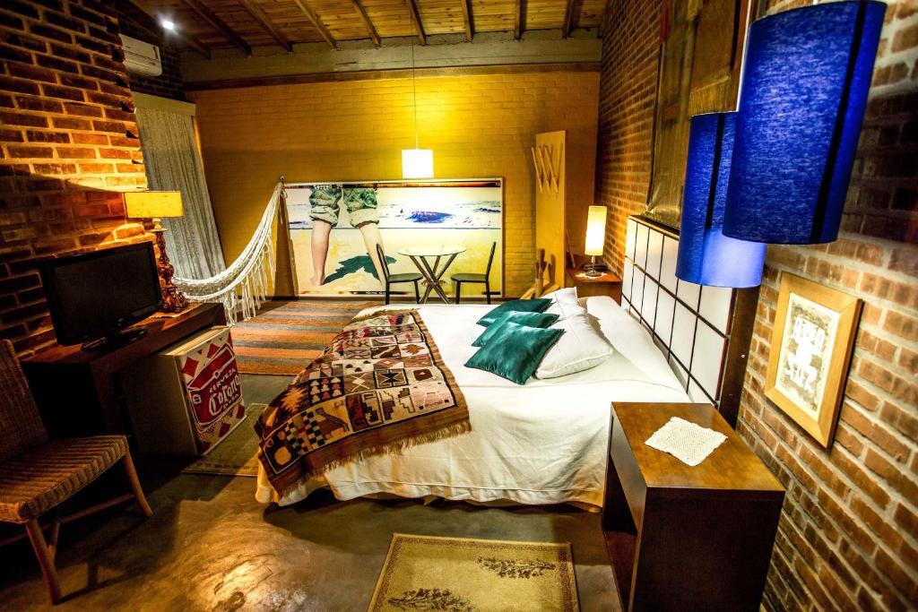 Cama ou camas em um quarto em Pier 704