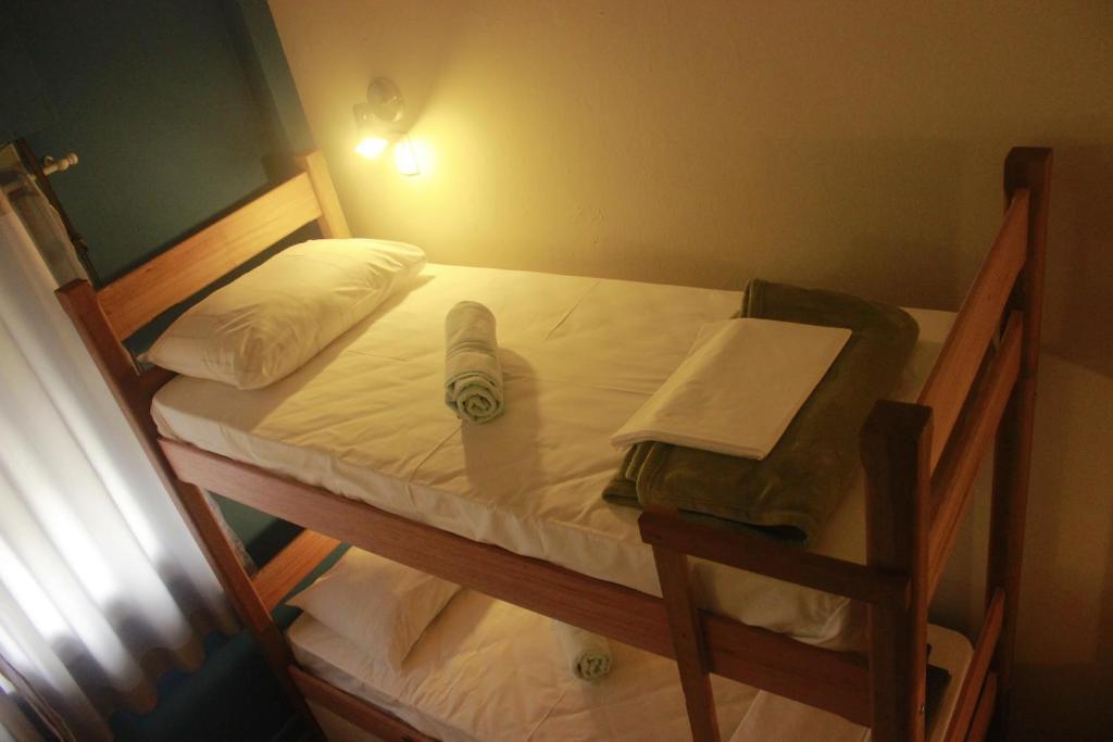 Cama ou camas em um quarto em The Hostel Paulista
