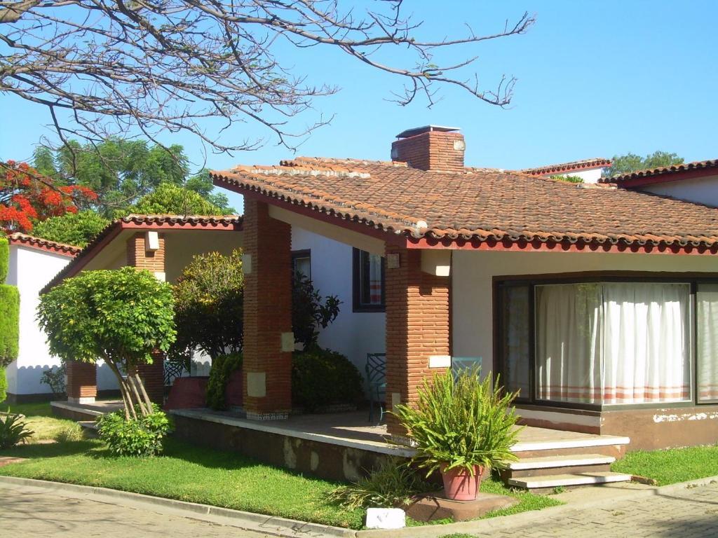 Villas del sol hotel bungalows san jacinto amilpas for Bungalows jardin del sol
