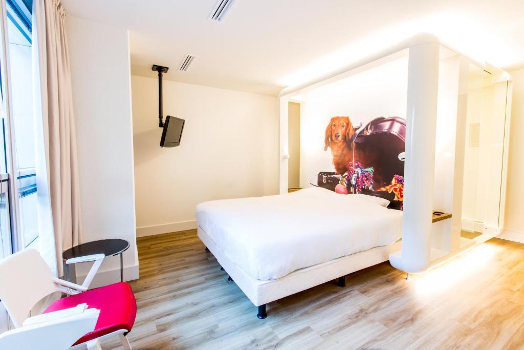 Cama ou camas em um quarto em Qbic Hotel WTC Amsterdam