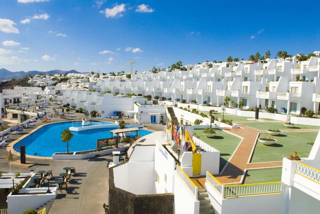 Bellevue apartamentos aquarius t as reserva tu hotel - Apartamentos baratos en lanzarote puerto del carmen ...