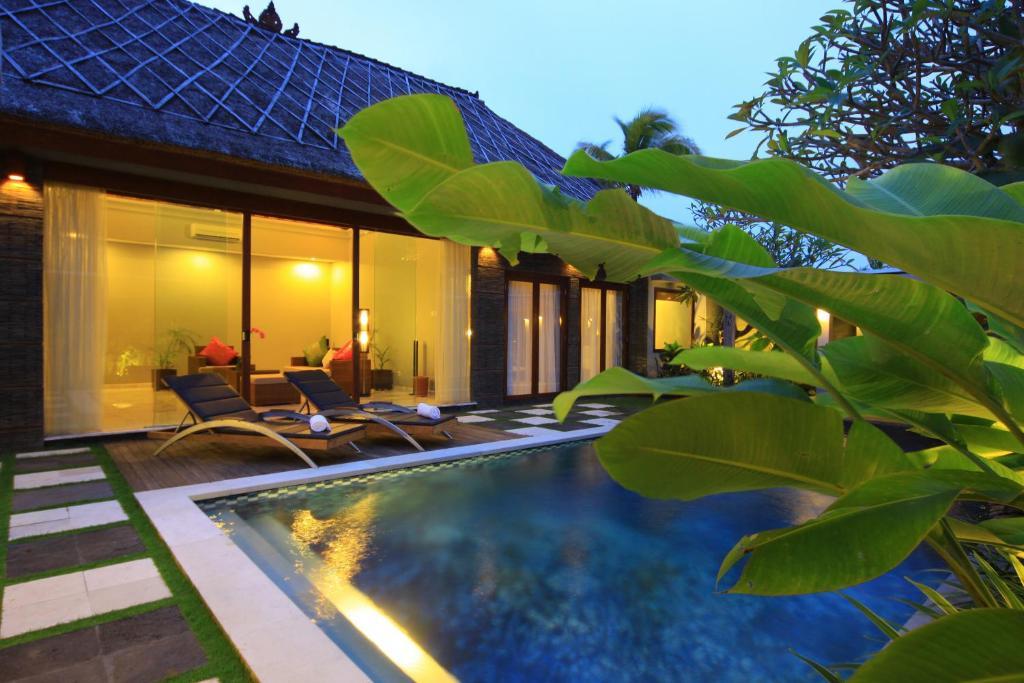 Abi bali resort and villa kuta book your hotel with for Bali resort villa