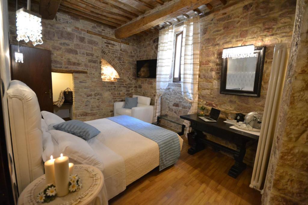 Cama ou camas em um quarto em Case Brizi Assisi