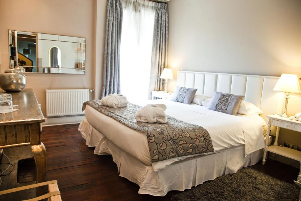 Cama ou camas em um quarto em Mito Casa Hotel Boutique