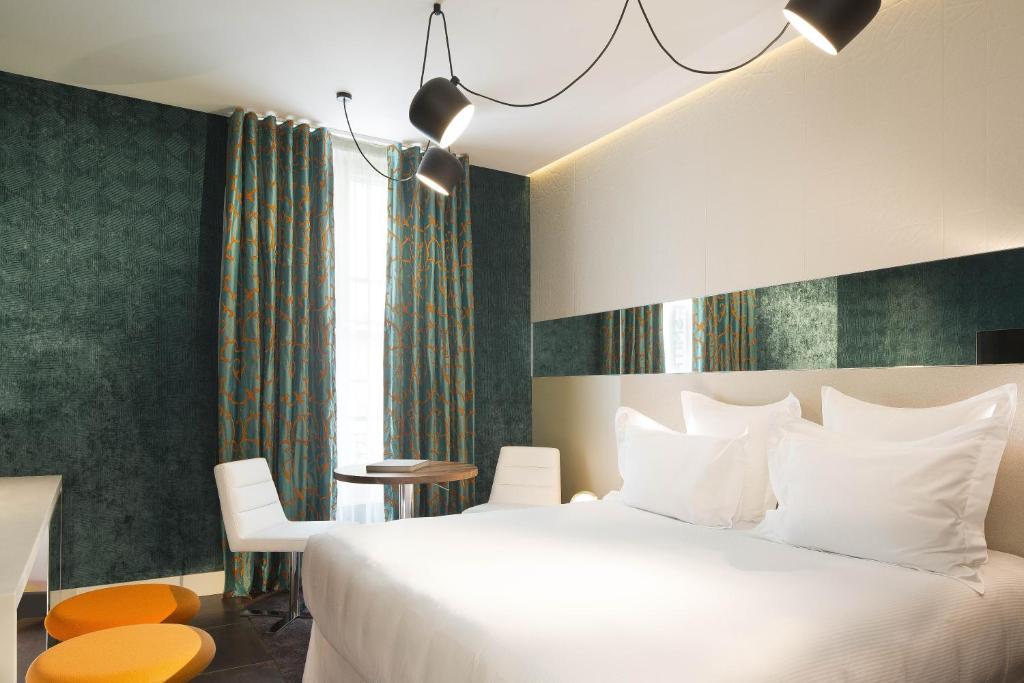 Cama ou camas em um quarto em Hotel Dupond-Smith