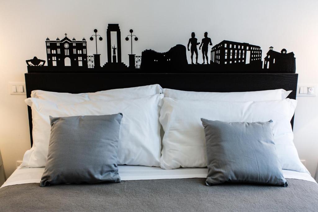 Cama ou camas em um quarto em Rhegion B&B