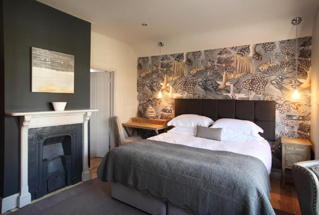 מיטה או מיטות בחדר ב-No 33, HUNSTANTON