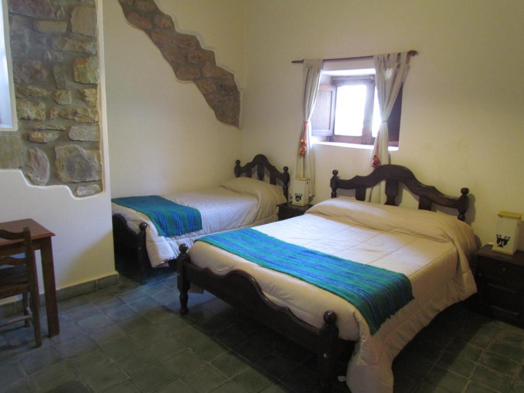 Una cama o camas en una habitación de La Casa del Indio
