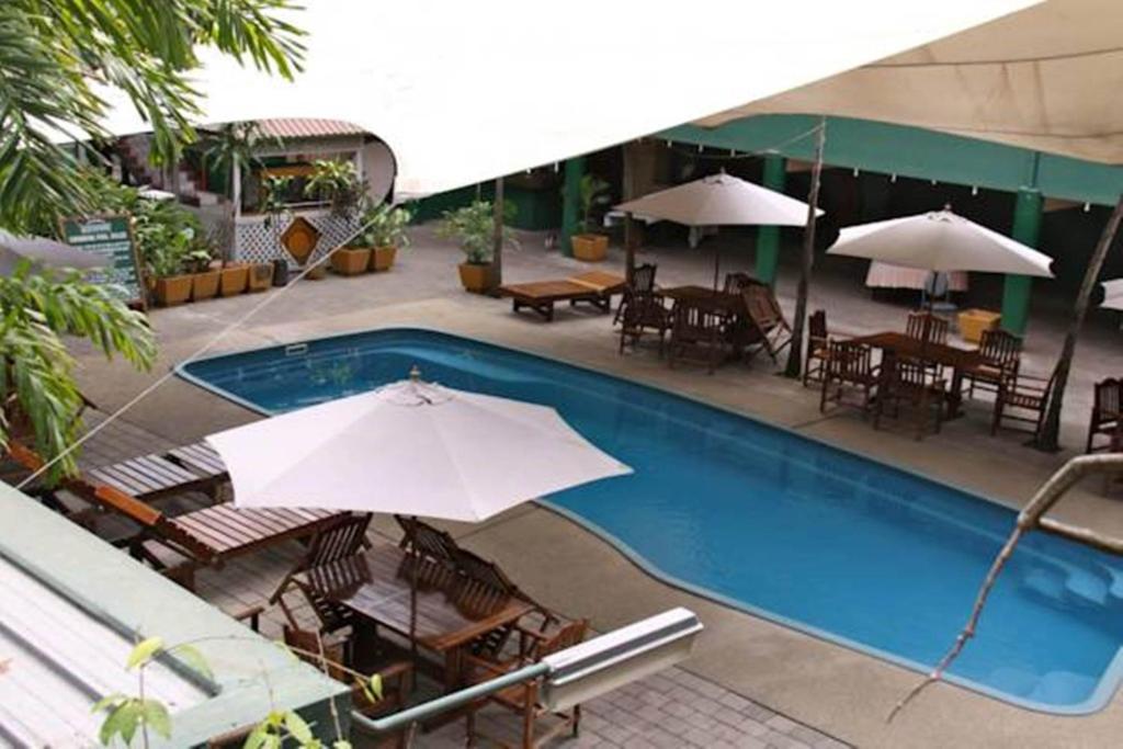 hideaway hotel port moresby viamichelin informatie en online reserveren. Black Bedroom Furniture Sets. Home Design Ideas
