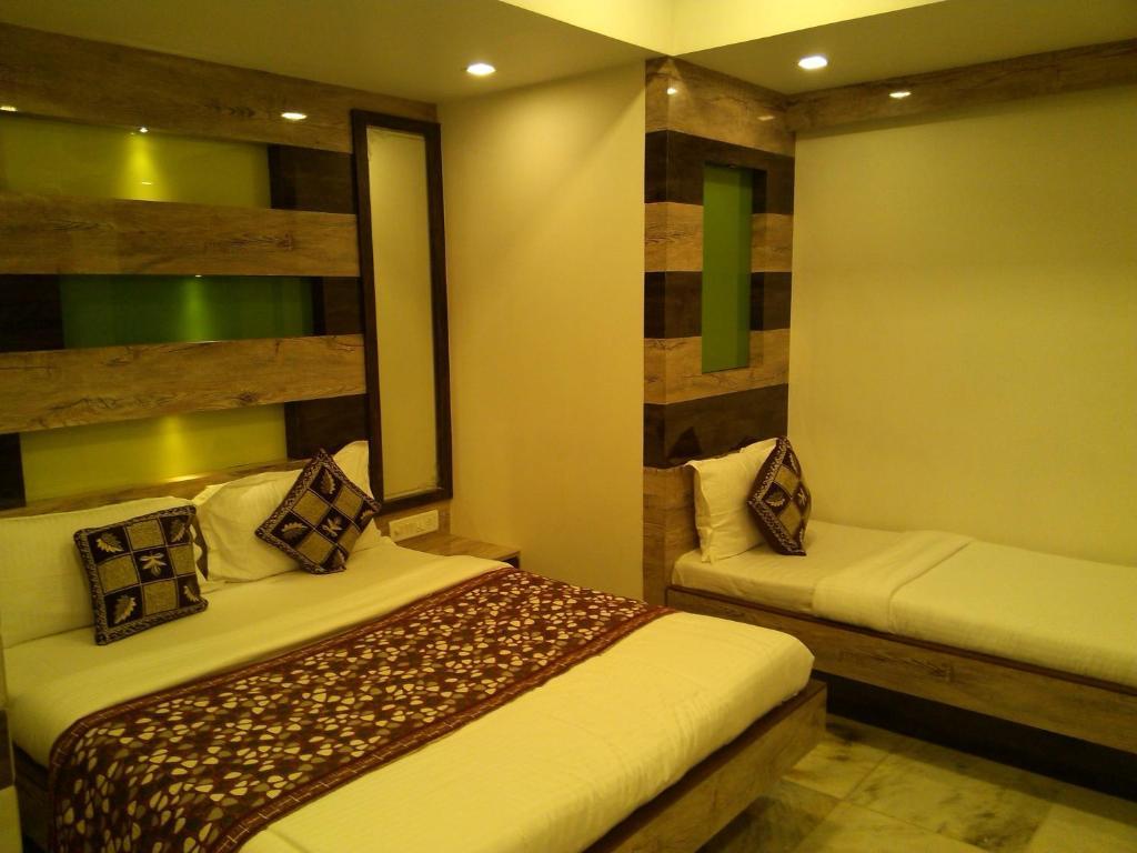Cama ou camas em um quarto em Hotel Ocean Residency