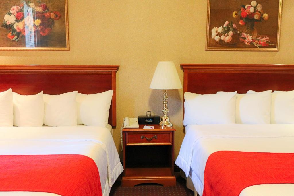 מיטה או מיטות בחדר ב-Hotel Newton