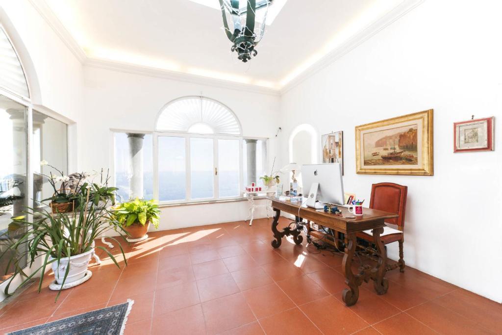 La casa di peppe guest house villa positano reserva for Piani di casa con guest house indipendente