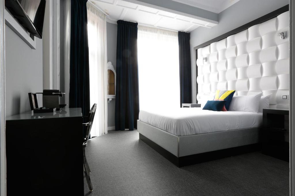 chambres d 39 h tes amra barcelona gran via chambres d 39 h tes barcelone. Black Bedroom Furniture Sets. Home Design Ideas