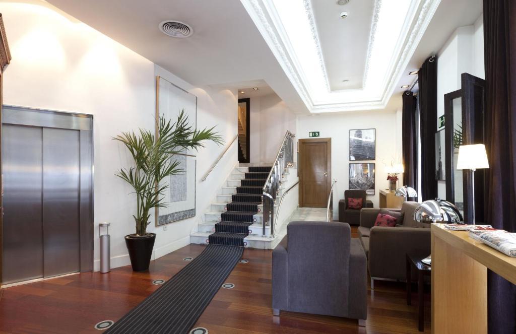Quatro puerta del sol madrid reserva tu hotel con for Hotel madrid sol