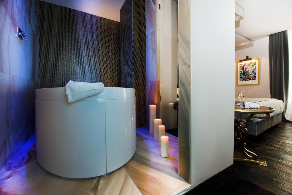 Um banheiro em HT6 Hotel Roma