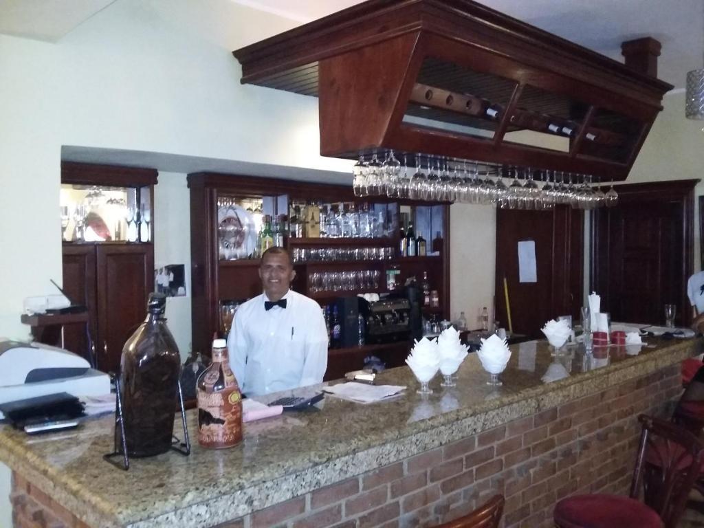 La sala de estar o bar de Hotel Cortecito Inn Bavaro