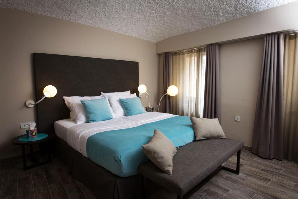 Cama ou camas em um quarto em Cacao Rooms