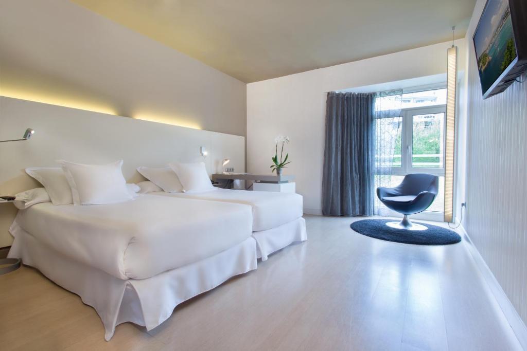 سرير أو أسرّة في غرفة في بارسيلو كوستا فاسكا