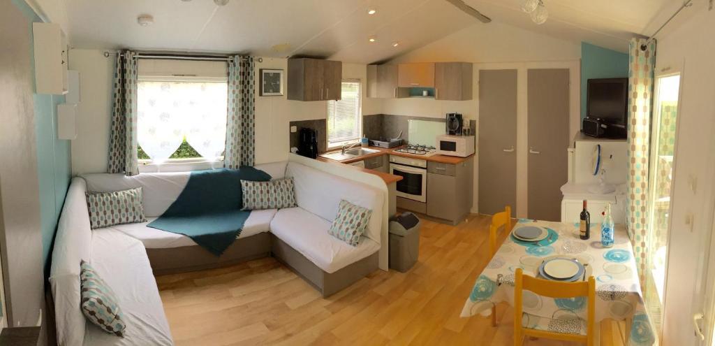 Mobil home les charmettes casas de vacaciones la palmyre for Casa de jardin mobile home park