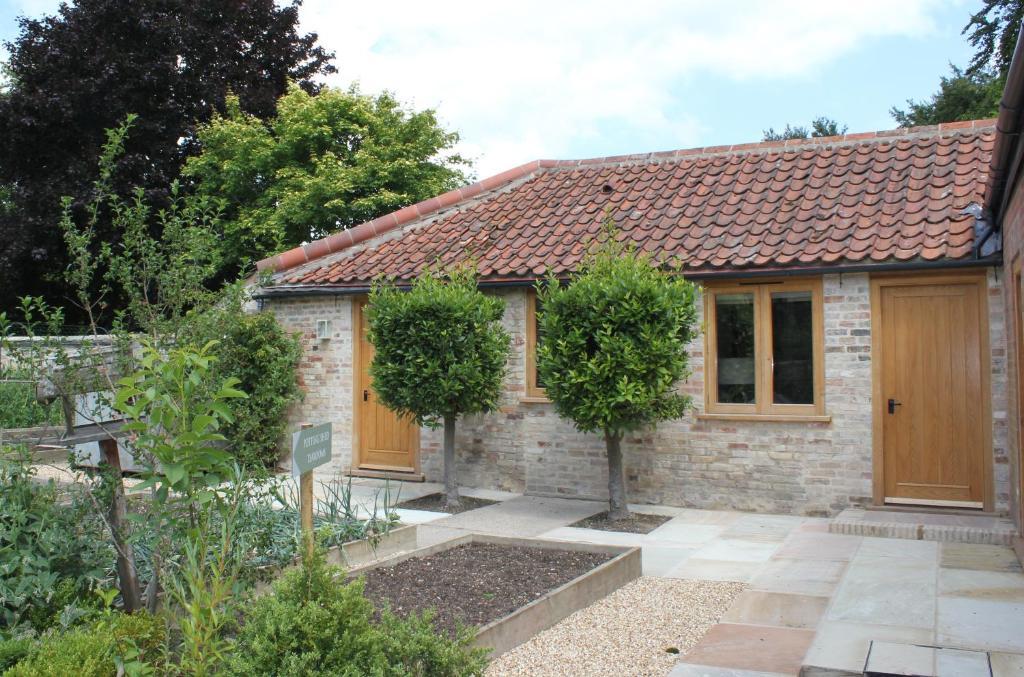 Chippenham park kitchen garden rooms newmarket for Garden rooms b q