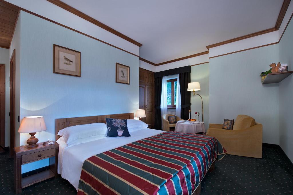Boutique hotel villa blu cortina cortina d 39 ampezzo book your hotel with viamichelin - Cortina boutique ...