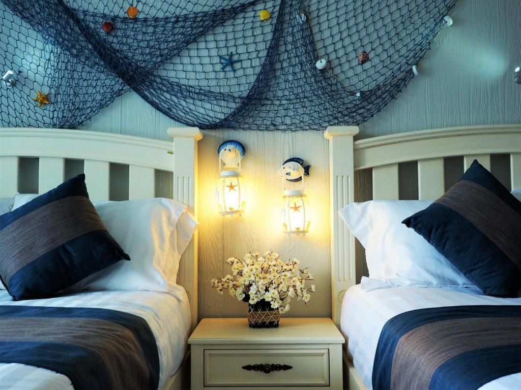 Giường trong phòng chung tại Ancora Blu Boutique Hotel B&B