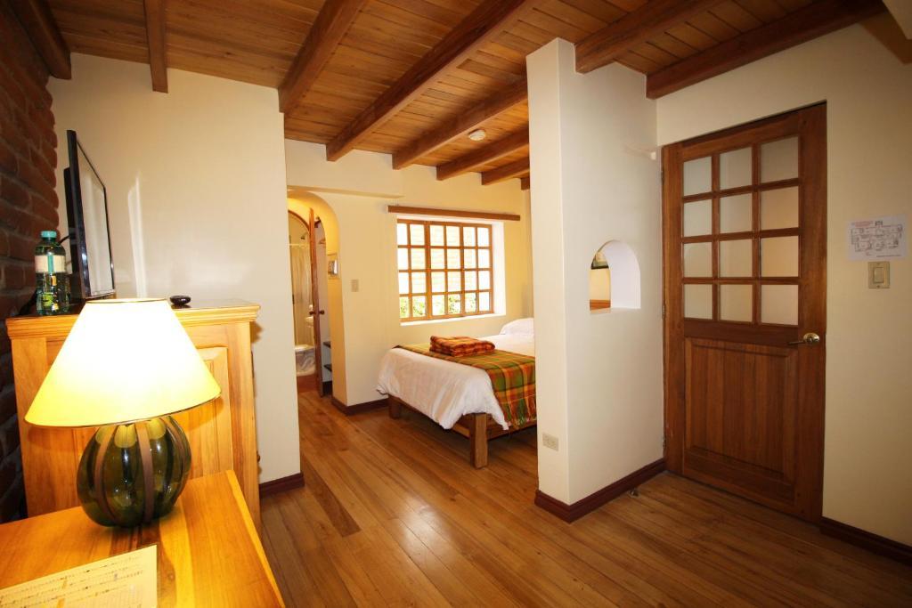 Cama ou camas em um quarto em Hotel Vieja Cuba