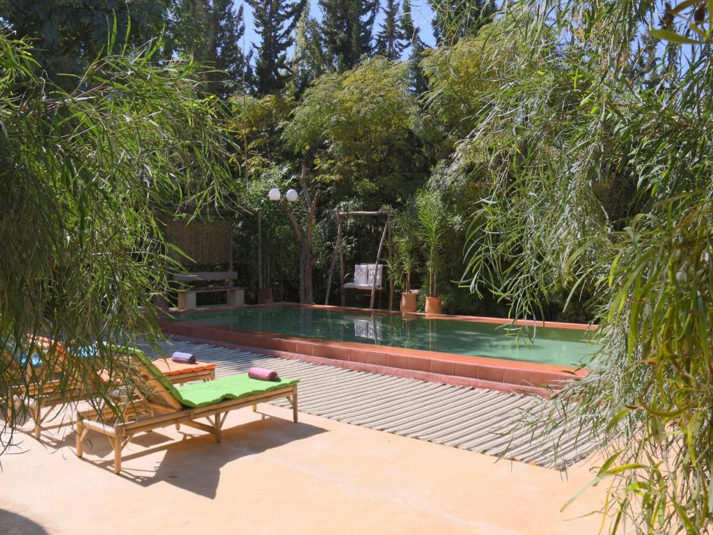 Le jardin tougana campement lodge tassoultante for Hotel le jardin 07700