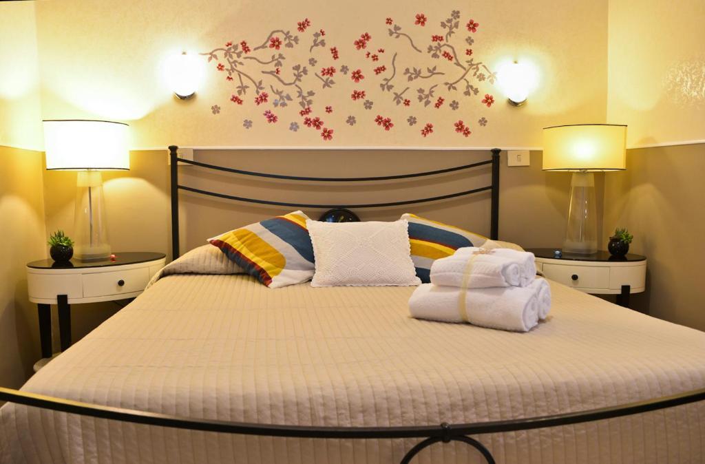 מיטה או מיטות בחדר ב-Hotel Di Rienzo