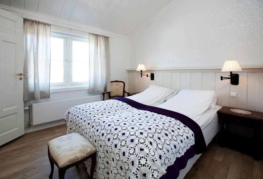 Giường trong phòng chung tại Erzscheidergaarden