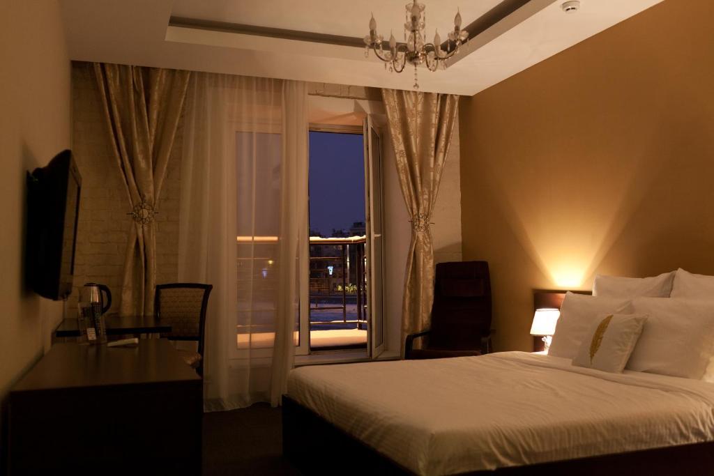 מיטה או מיטות בחדר ב-Moscow Point - Red October