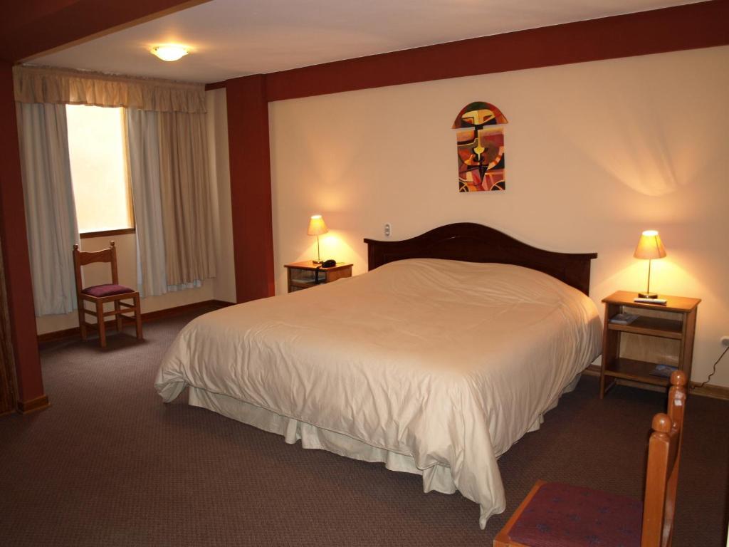 Cama ou camas em um quarto em Qelqatani Hotel