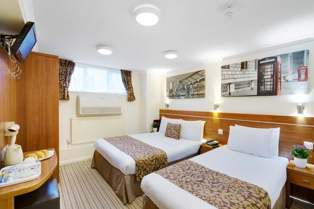 Queens park hotel london book your hotel with viamichelin for 48 queensborough terrace london w2 3sj