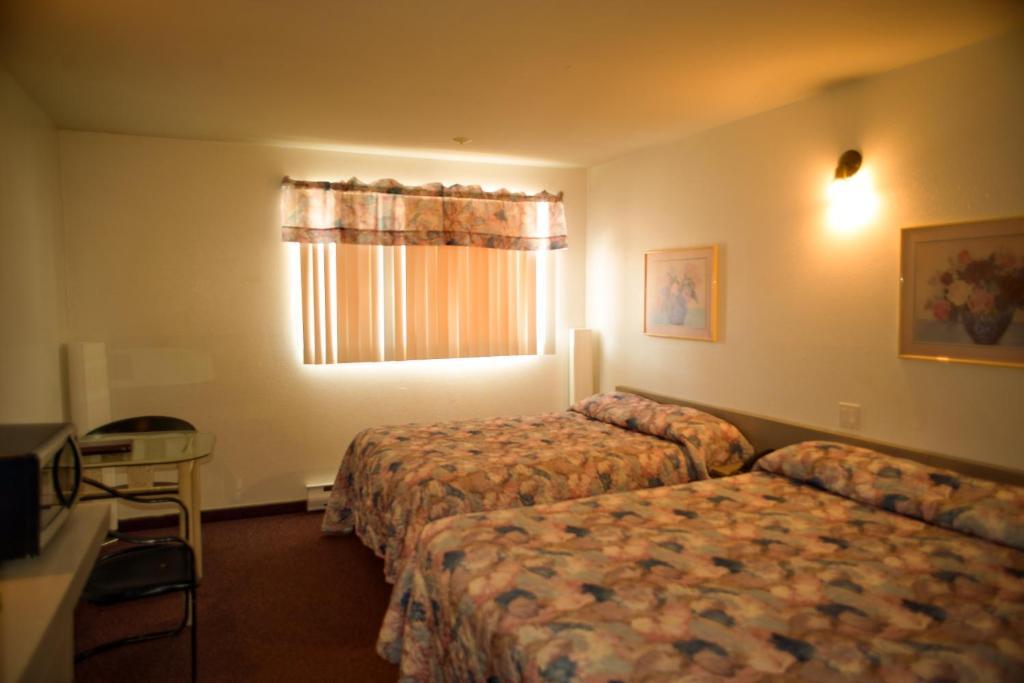 Motel du rosier baie comeau reserva tu hotel con for Motel con piscina privada