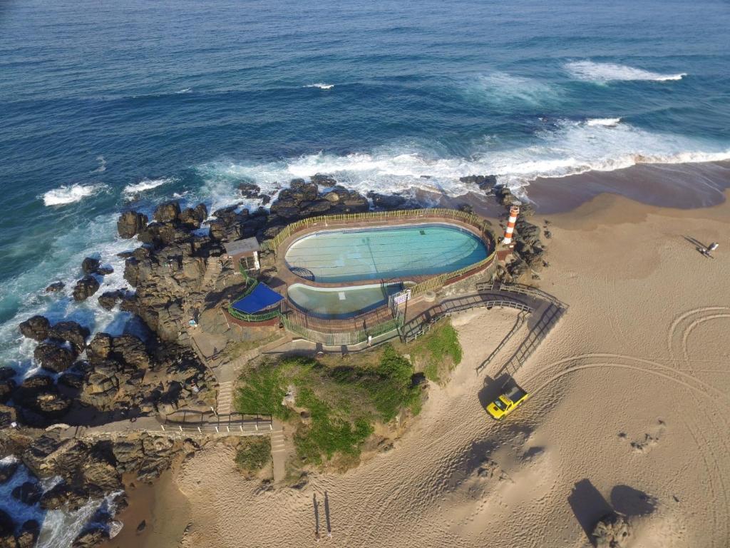 <div data-et-view=NAFQCDCcdXDPdFO:1</div Beachfront Cabanas