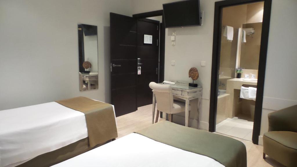 Moderno madrid reserva tu hotel con viamichelin for Hotel moderno madrid booking