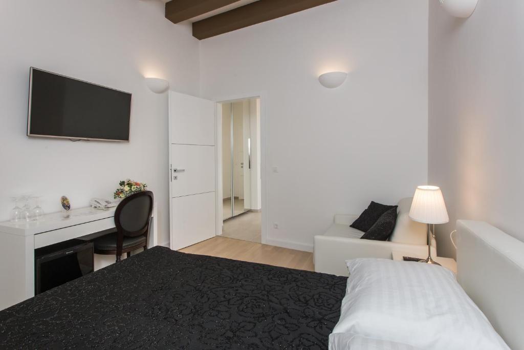 Um quarto em Rooms Klarisa Palace