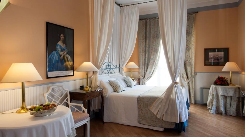 Cama ou camas em um quarto em Hotel Victoria