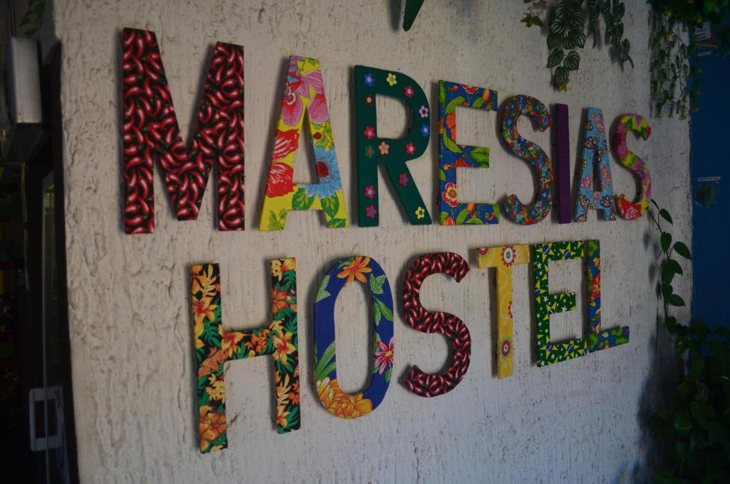 Um certificado, prêmio, placa ou outro documento exibido em Maresias Hostel