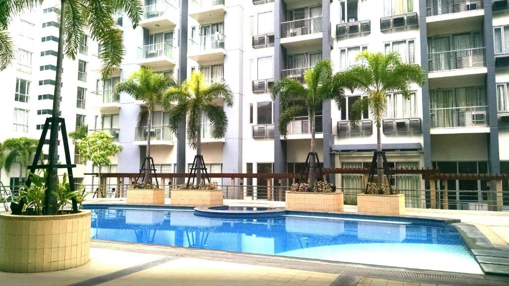 3n palm tree villas manila book your hotel with for Palm tree villas 1