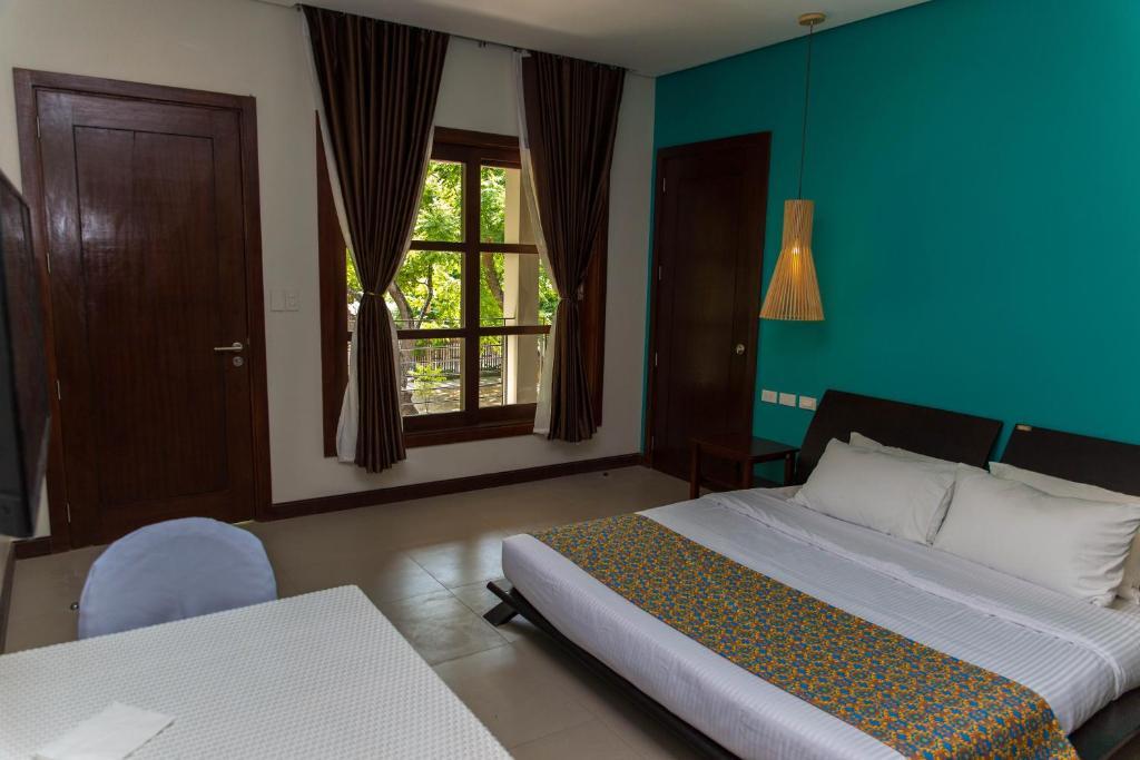 chambres d 39 h tes karancho beach house chambres d 39 h tes mactan. Black Bedroom Furniture Sets. Home Design Ideas