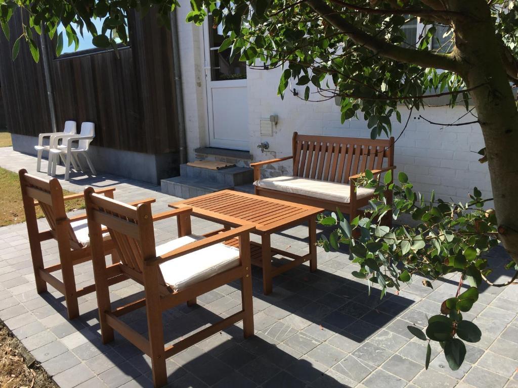 Uma varanda ou outra área externa em Cottage Fleuri